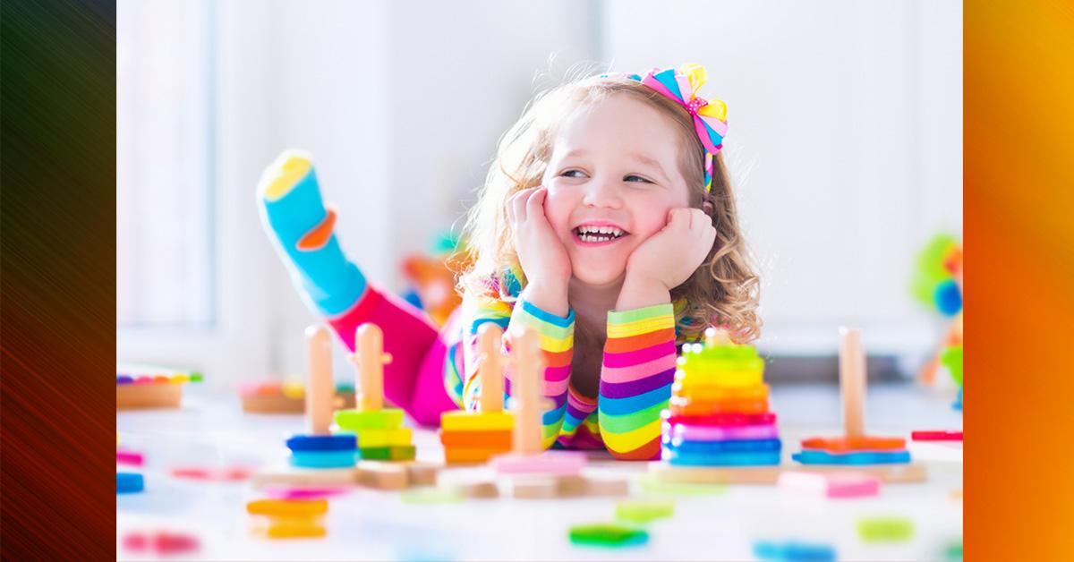 girl playing on floor in nursery