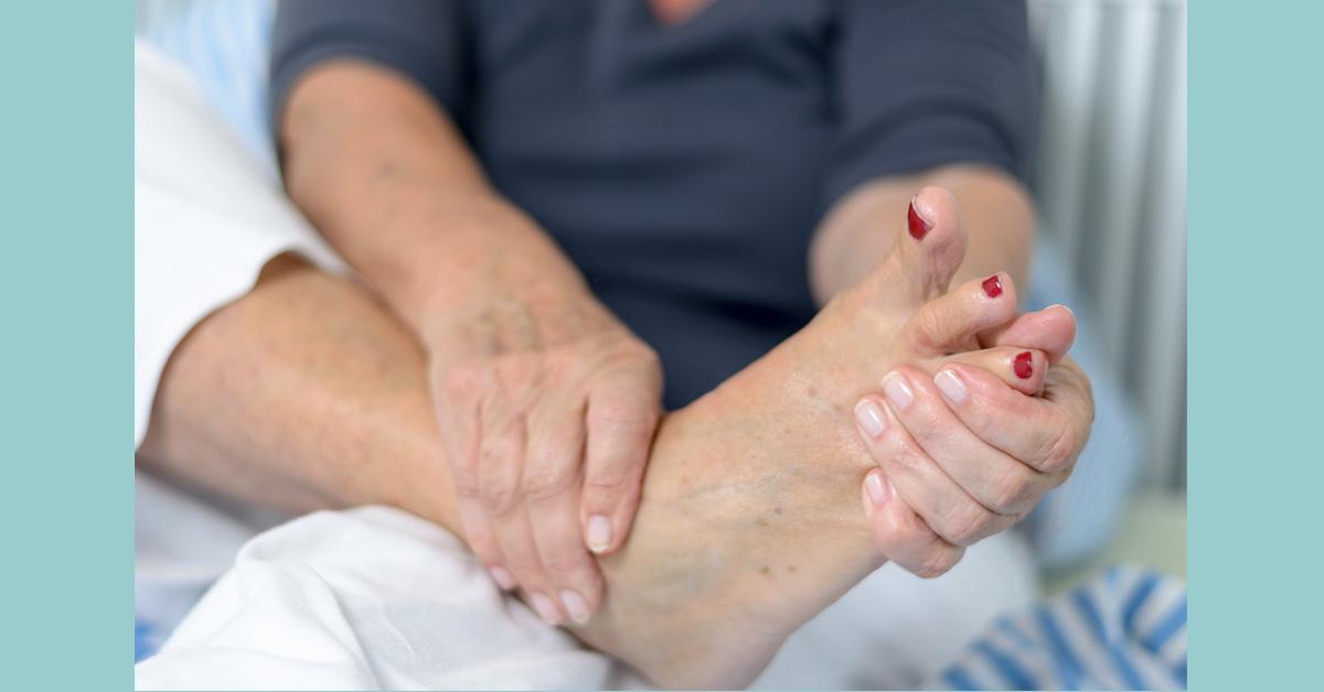 woman massaging tired feet